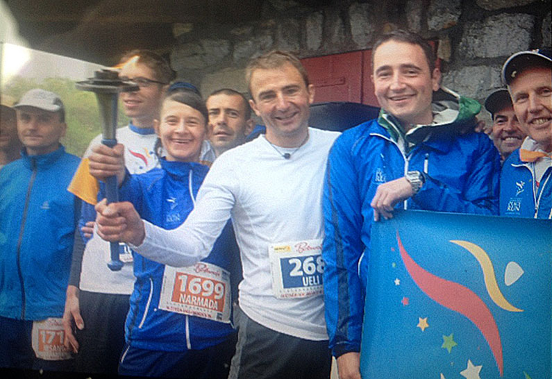 Ueli-Steck-holds-Peace-Torch-29-June-2014